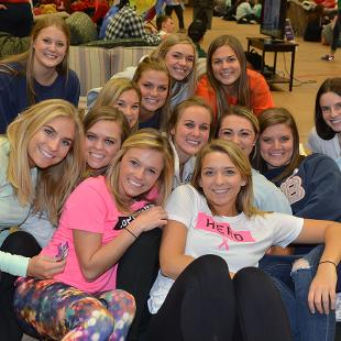 Fourteen females pose for a photo during the Relay for Life campus event.