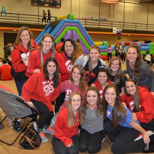 Thirteen women pose for a photo during the Relay for Life campus event.