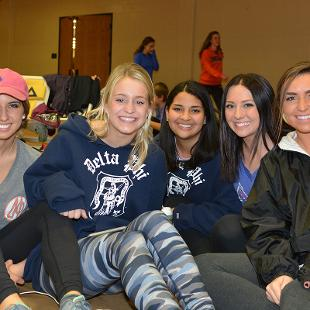 Five females pose for a photo during the Relay for Life campus event.