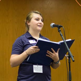 One female student leaders addresses Relay for Life participant in the Dow Center gym.