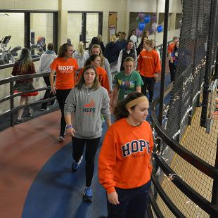 Students walk on the Dow Center track during the Relay for Life event.