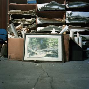 A photo of a painting that once hung in an abandoned paper mill in Plainwell, Michigan