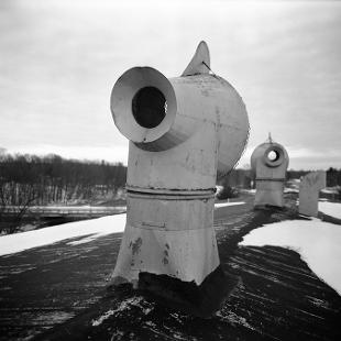 An exterior photo of a smokestack in an abandoned paper mill in Plainwell, Michigan