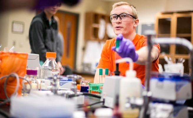 Student using lab equipment
