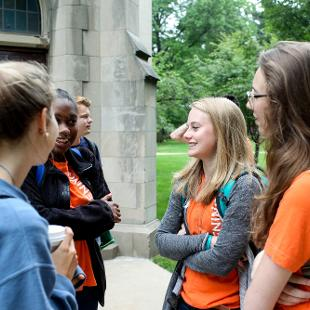 Group of female student talking outside Dimnent Chapel