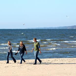 Students taking a walk alongside the Lake Michigan Shore