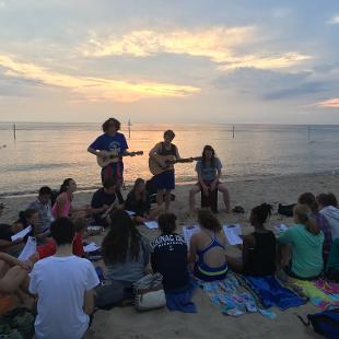 Group worship on the beach