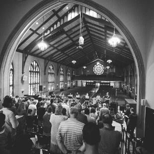 A group worshiping in Dimnent Chapel
