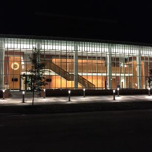 A front-facing shot of the Jack H. Miller Center at night