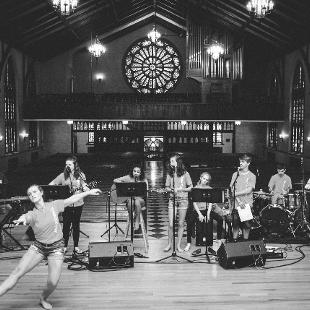 A female worship dancer performs with the worship band in Dimnent Chapel