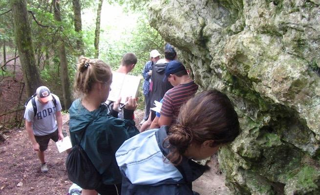 Students examining rock formations