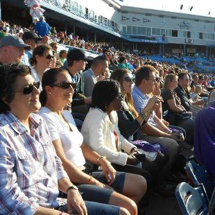 International families at a Grand Rapids Whitecaps baseball game