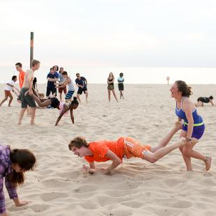 Group activities occur on the beach at Holland State Park