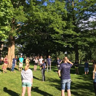 Several Awakening students gather for games in the pine grove.