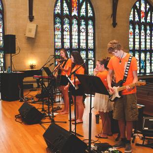 A worship band leading worship in Dimnent Chapel