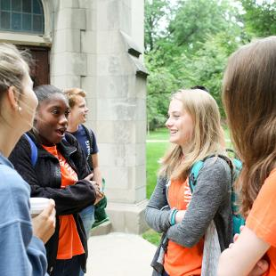 A group of female students talking outside of Dimnent Chapel