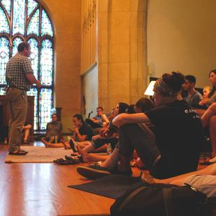 Dean of the Chapel, Trygve Johnson, addresses a group of Awakening students