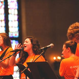 A worship band performing in Dimnent Chapel