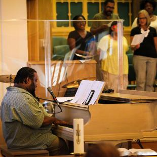 A piano player at a church service