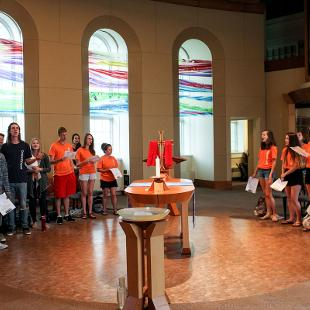 A group of students at a church service in Holland