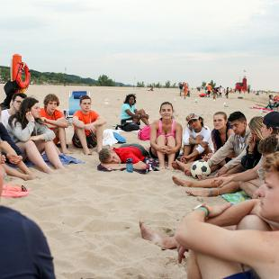 Group worship on the beach at Holland State Park