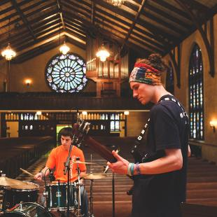 The worship band playing in Dimnent Chapel