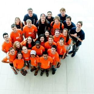 A group of Awakening students pose for an aerial picture