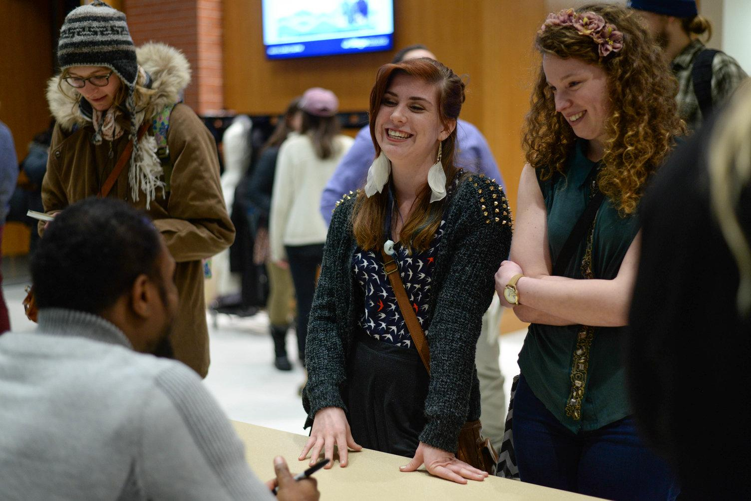 Students with Jamaal May at book signing
