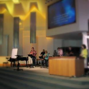 Ministry student leading Sunday morning worship at a church in Zeeland.