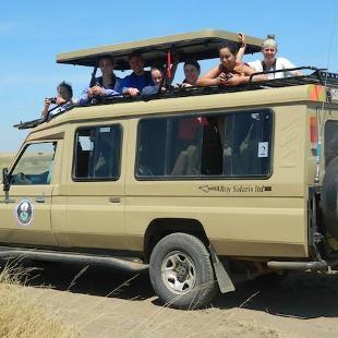 Hope biology students on safari with Eldon Greij in a Roy Safaris land cruiser.