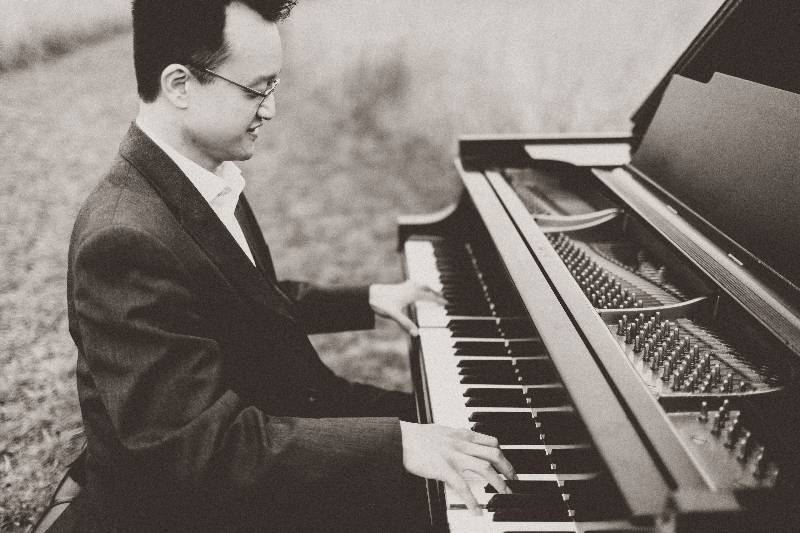 Dr. Andrew Le playing the piano