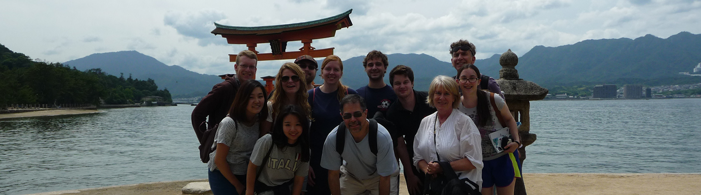Andrew Dell'Olio with students in Japan