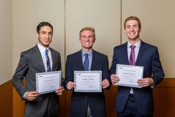 Three members of the fall 2019 Hope College Commercial Lending Team smile as they recieve certificates for their second-place finish