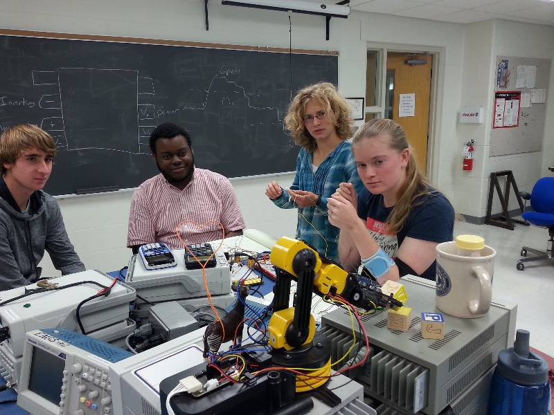 Students in circuits lab control robot using their muscle signals and a circuit they built