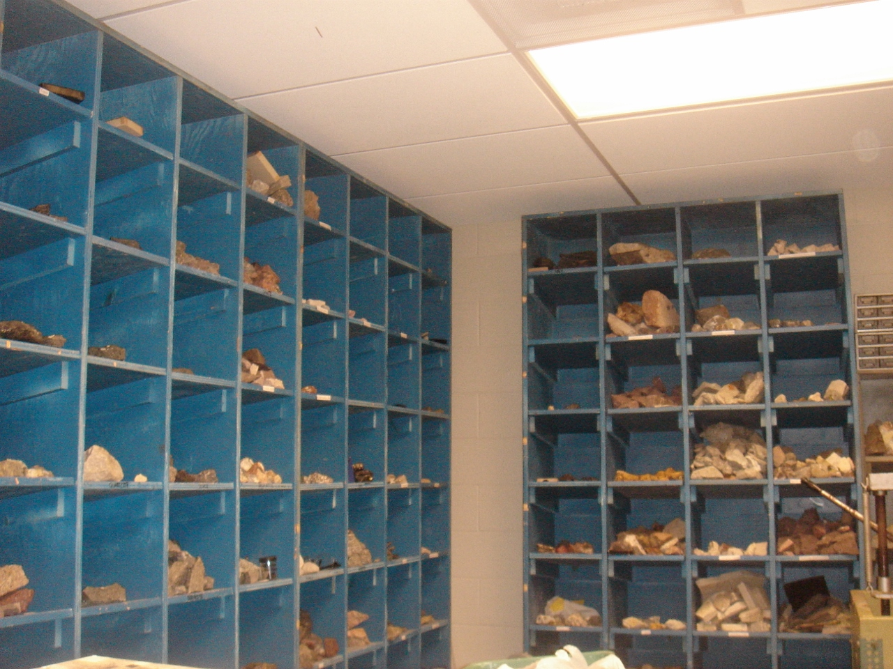 floor to ceiling bins holding rock samples for classroom use