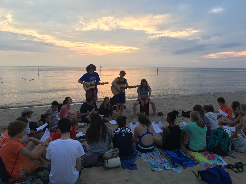 Awakening students on the beach