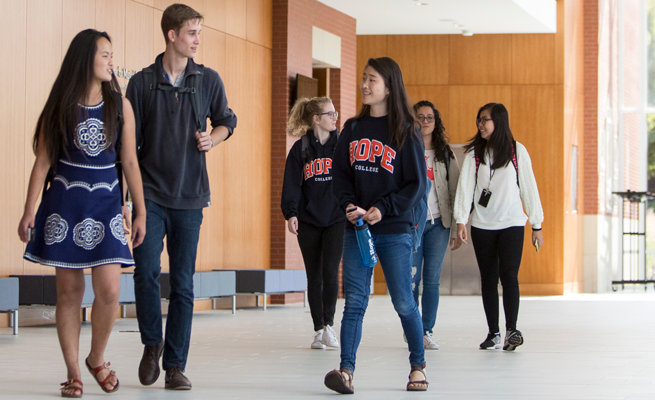 Phelps Scholars casually walk through lobby of the Jack H. Miller Center for Musical Arts.