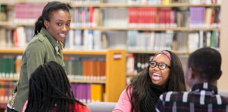 Phelps Scholars studying and laughing