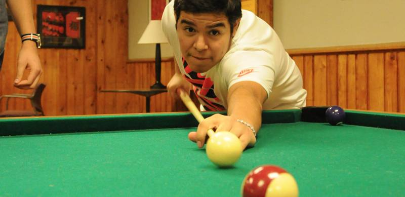 A Phelps Scholar shooting pool