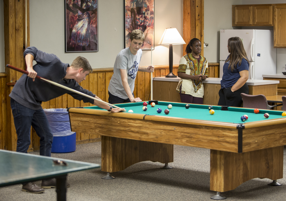 Phelps Scholars shooting pool in Scott Hall.