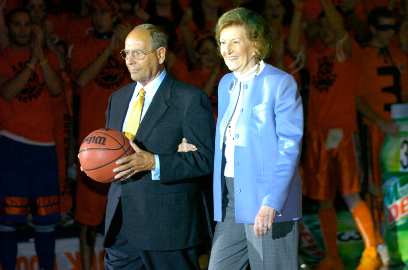 Richard and Helen DeVos present the game ball for the first home men's basketball game at Hope College's Richard and Helen DeVos Fieldhouse on Saturday, Nov. 19, 2005.