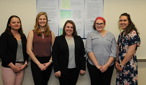 The students from left to right in the group photo are Cameron Everse, Lauren Evert, Rebecca Messnick, Abby Rakus and Micah Manthei