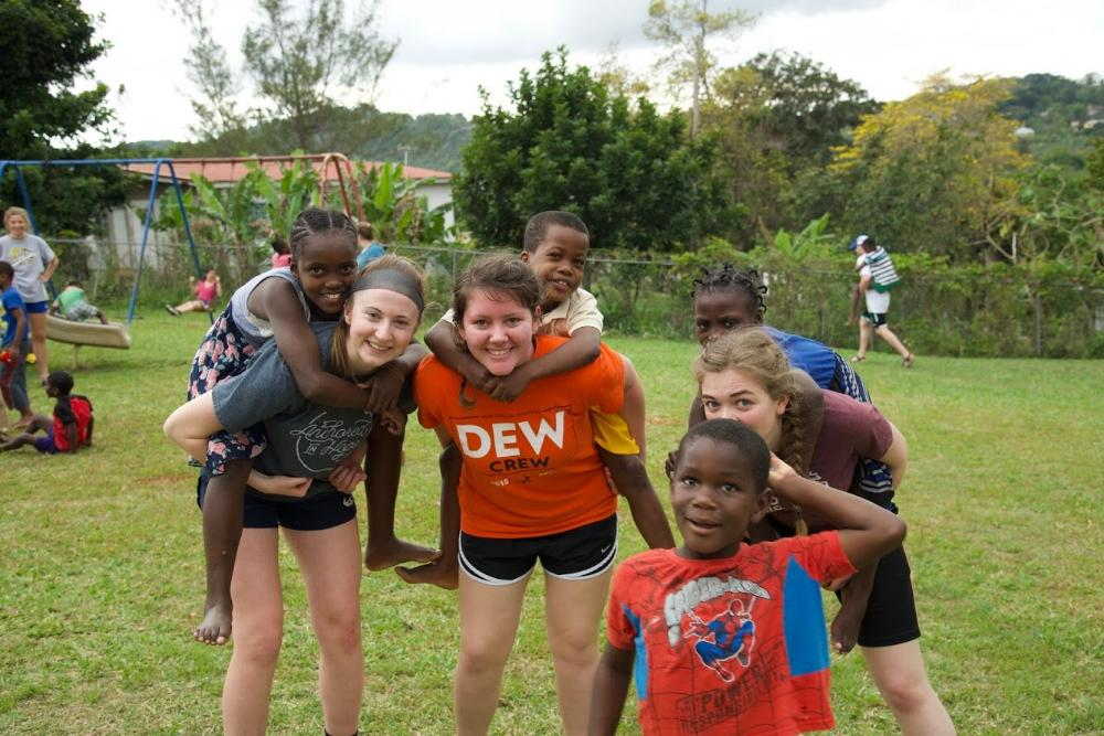 Hope College students playing with children in Jamaica