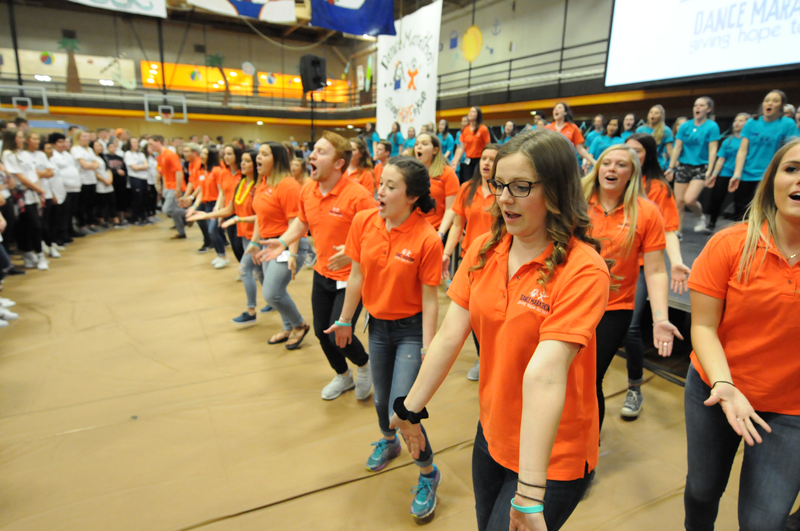 Dream Team members dancing and laughing at Dance Marathon