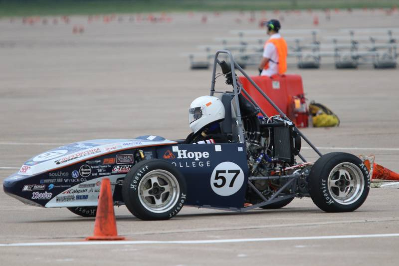 A Hope College Formula Racing student waiting in their car for the race to begin.